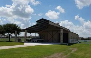 Large Custom Metal Barn with Front Overhang